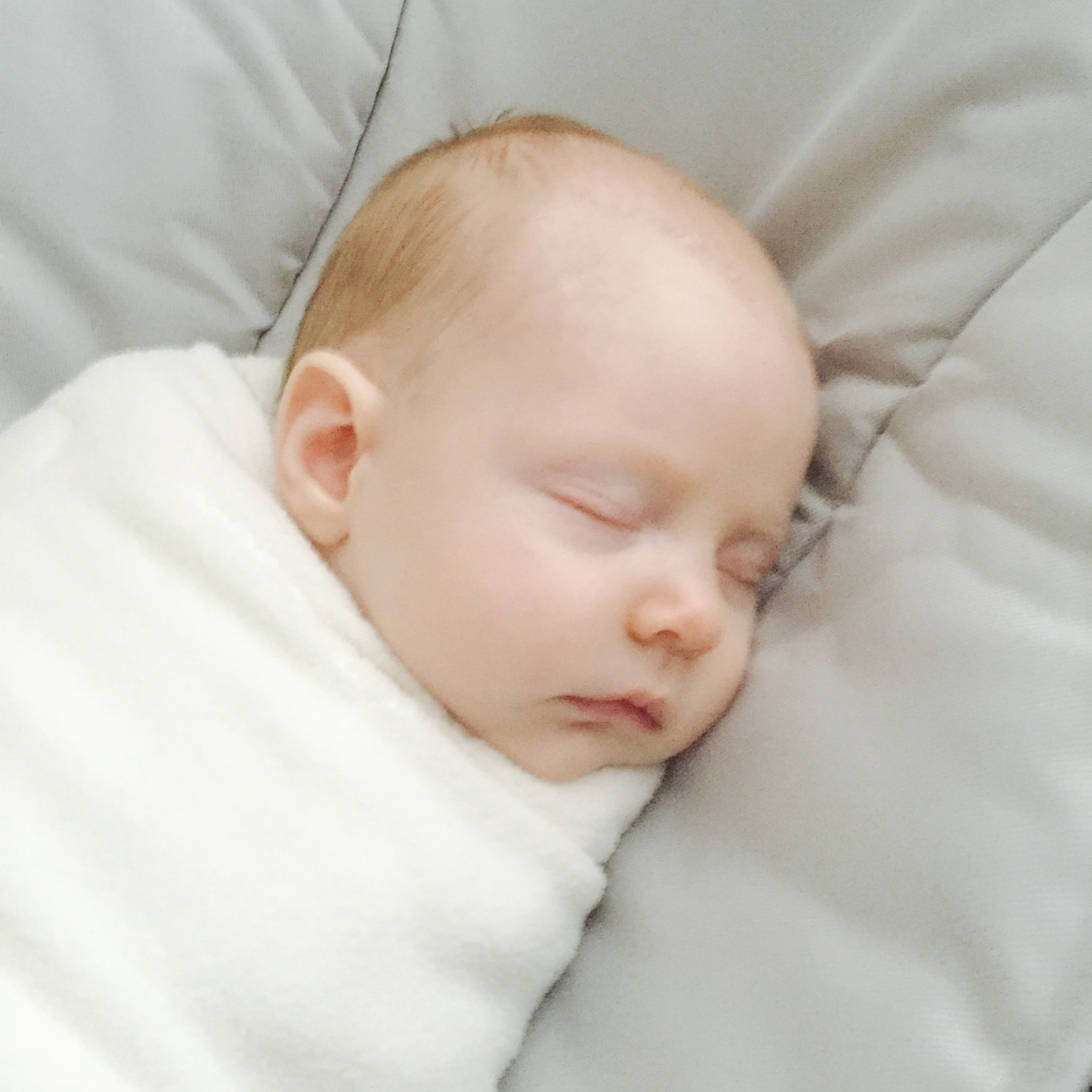 swaddled baby in mamaroo