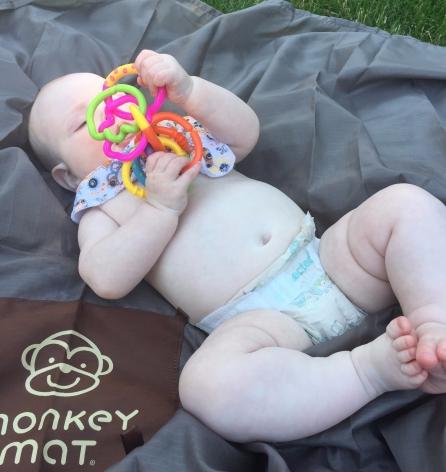 baby on monkey mat